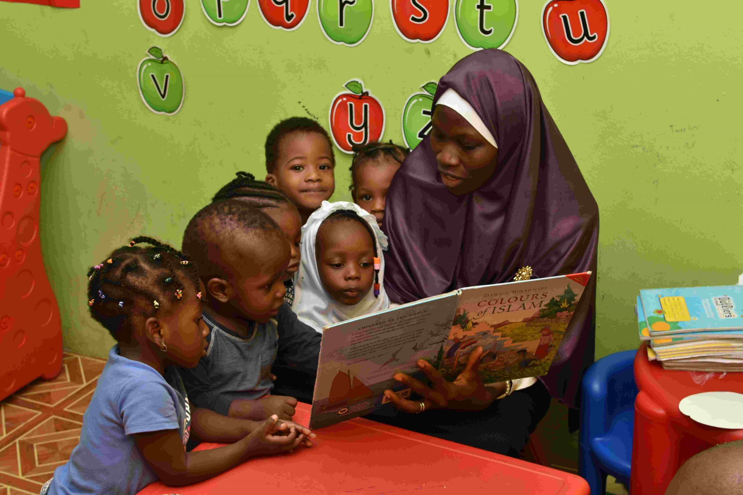 A reading session in Toddler class.